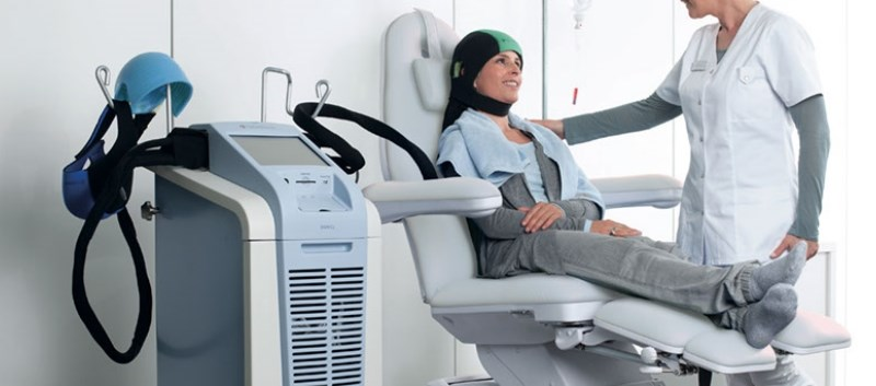 The cap is a computer controlled system that circulates liquid to cool the scalp during chemotherapy