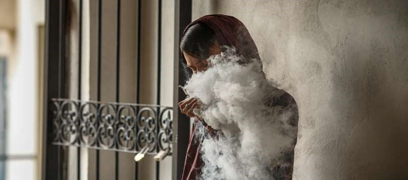 Small devices deliver addictive nicotine dose without noxious taste; pose danger to adolescents.